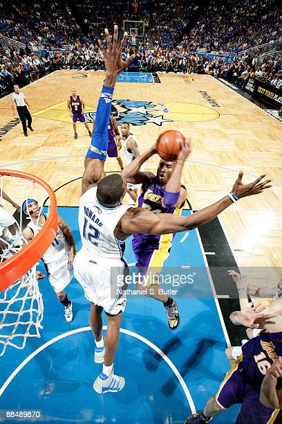 Kobe Bryant of the Los Angeles Lakers drives for a shot attempt against Dwight Howard of the Orlando Magic in Game Five of the 2009 NBA Finals at...