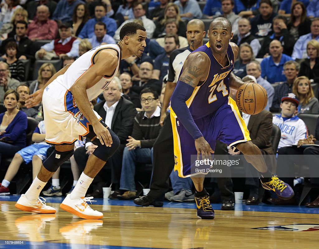 Kobe Bryant #24 of the Los Angeles Lakers drives on Thabo Sefolosha #2 of the Oklahoma City Thunder December 7, 2012 at Chesapeake Energy Arena in Oklahoma City, Oklahoma. Oklahoma City defeated Los Angeles 114-108.
