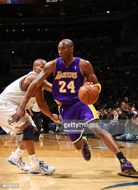 Kobe Bryant of the Los Angeles Lakers drives past Randy Foye of the Washington Wizards at the Verizon Center on January 26 2010 in Washington DC NOTE...