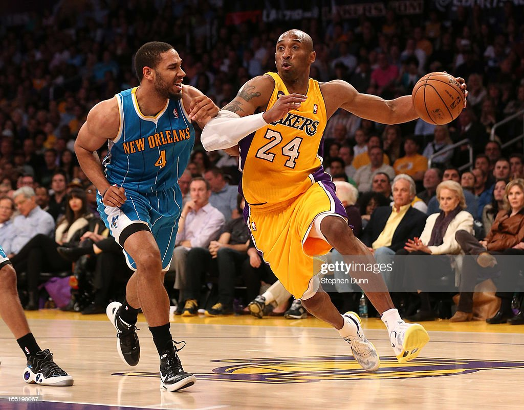 Kobe Bryant #24 of the Los Angeles Lakers drives past Xavier Henry #4 of the New Orleans Hornets at Staples Center on April 9, 2013 in Los Angeles, California. The Lakers won 104-96.