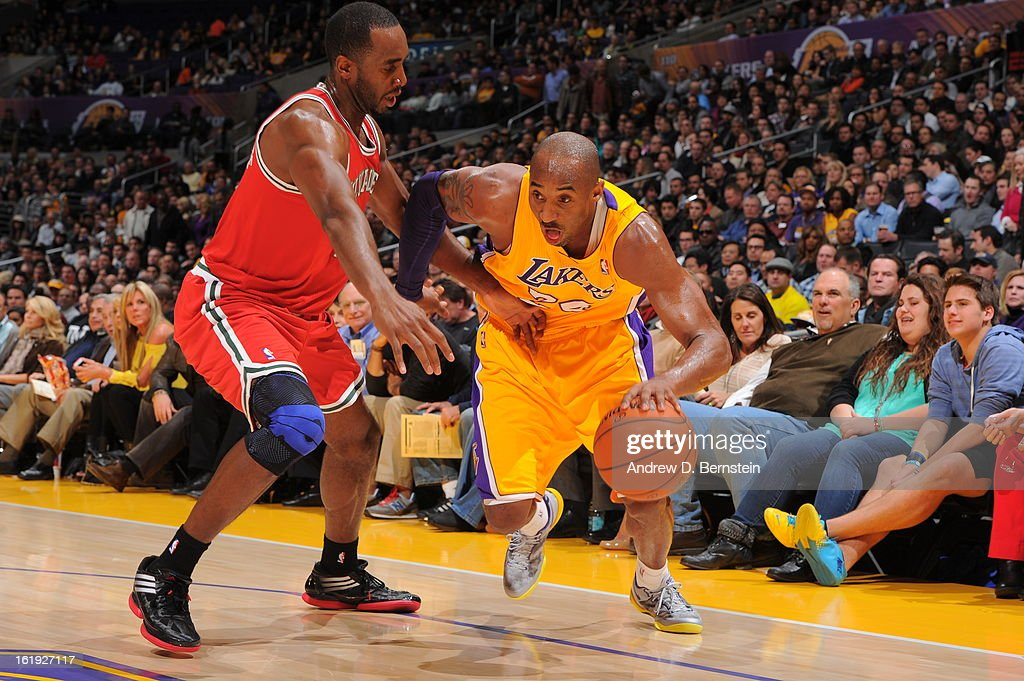 <a gi-track='captionPersonalityLinkClicked' href=/galleries/search?phrase=Kobe+Bryant&family=editorial&specificpeople=201466 ng-click='$event.stopPropagation()'>Kobe Bryant</a> #24 of the Los Angeles Lakers drives strong to the basket against the Milwaukee Bucks at Staples Center on January 15, 2013 in Los Angeles, California.