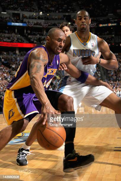 Kobe Bryant of the Los Angeles Lakers drives the ball against Arron Afflalo of the Denver Nuggets in Game Four of the Western Conference...