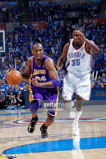 Kobe Bryant of the Los Angeles Lakers drives the ball up court followed by Kevin Durant of the Oklahoma City Thunder in Game Six of the Western...