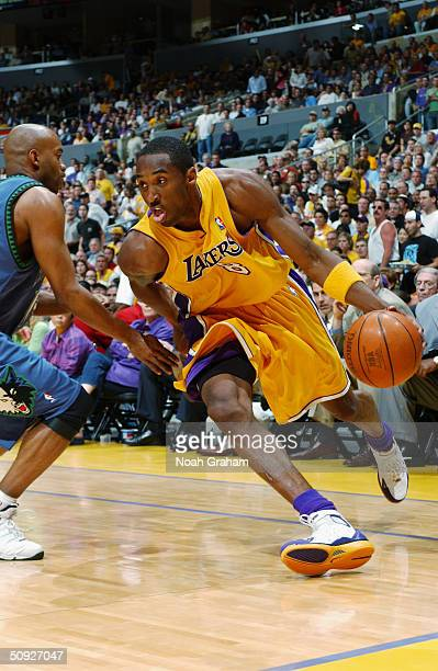 Kobe Bryant of the Los Angeles Lakers drives the baseline against Darrick Martin of the Minnesota Timberwolves in Game six of the Western Conference...