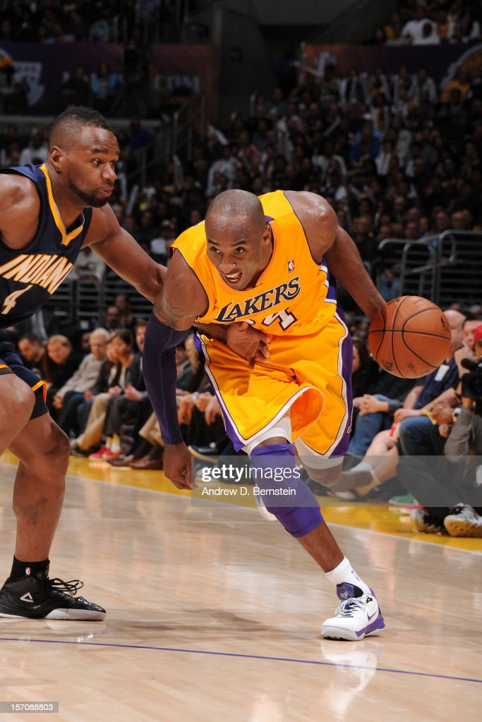 <a gi-track='captionPersonalityLinkClicked' href=/galleries/search?phrase=Kobe+Bryant&family=editorial&specificpeople=201466 ng-click='$event.stopPropagation()'>Kobe Bryant</a> #24 of the Los Angeles Lakers drives to the basket against Sam Young #4 of the Indiana Pacers at Staples Center on November 27, 2012 in Los Angeles, California.