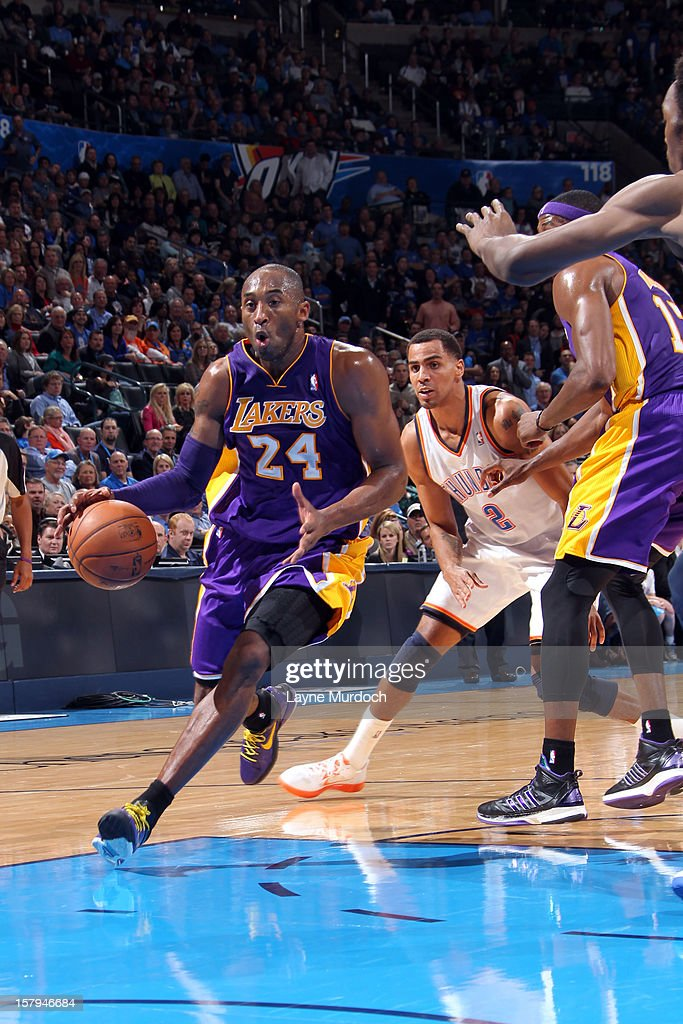 Kobe Bryant #24 of the Los Angeles Lakers drives to the basket against the Oklahoma City Thunder during an NBA game on December 7, 2012 at the Chesapeake Energy Arena in Oklahoma City, Oklahoma.