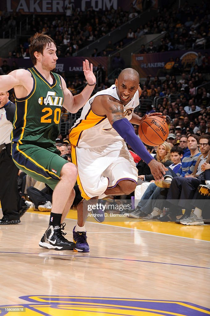 Kobe Bryant #24 of the Los Angeles Lakers drives to the basket against Gordon Hayward #20 of the Utah Jazz at Staples Center on December 9, 2012 in Los Angeles, California.