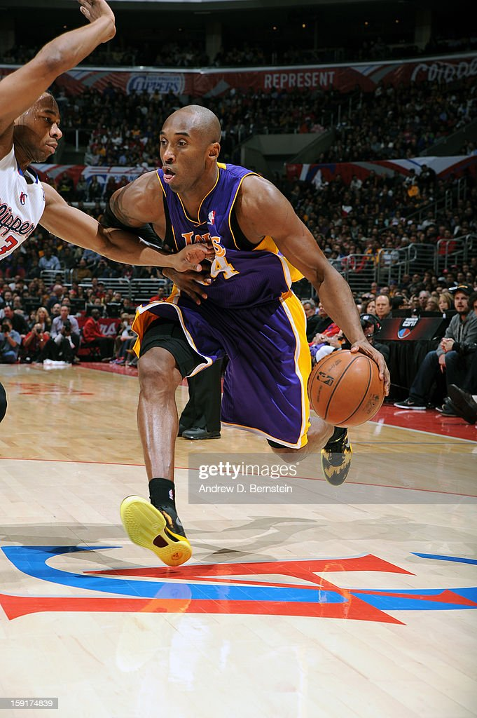 Kobe Bryant #24 of the Los Angeles Lakers drives to the basket against the Los Angeles Clippers at Staples Center on January 4, 2013 in Los Angeles, California.