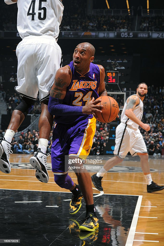 <a gi-track='captionPersonalityLinkClicked' href=/galleries/search?phrase=Kobe+Bryant&family=editorial&specificpeople=201466 ng-click='$event.stopPropagation()'>Kobe Bryant</a> #24 of the Los Angeles Lakers drives to the basket against the Brooklyn Nets on February 5, 2013 at the Barclays Center in the Brooklyn borough of New York City.