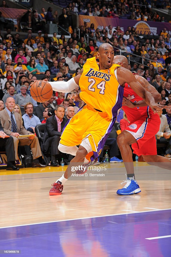 <a gi-track='captionPersonalityLinkClicked' href=/galleries/search?phrase=Kobe+Bryant&family=editorial&specificpeople=201466 ng-click='$event.stopPropagation()'>Kobe Bryant</a> #24 of the Los Angeles Lakers drives to the basket against the Los Angeles Clippers at Staples Center on February 14, 2013 in Los Angeles, California.