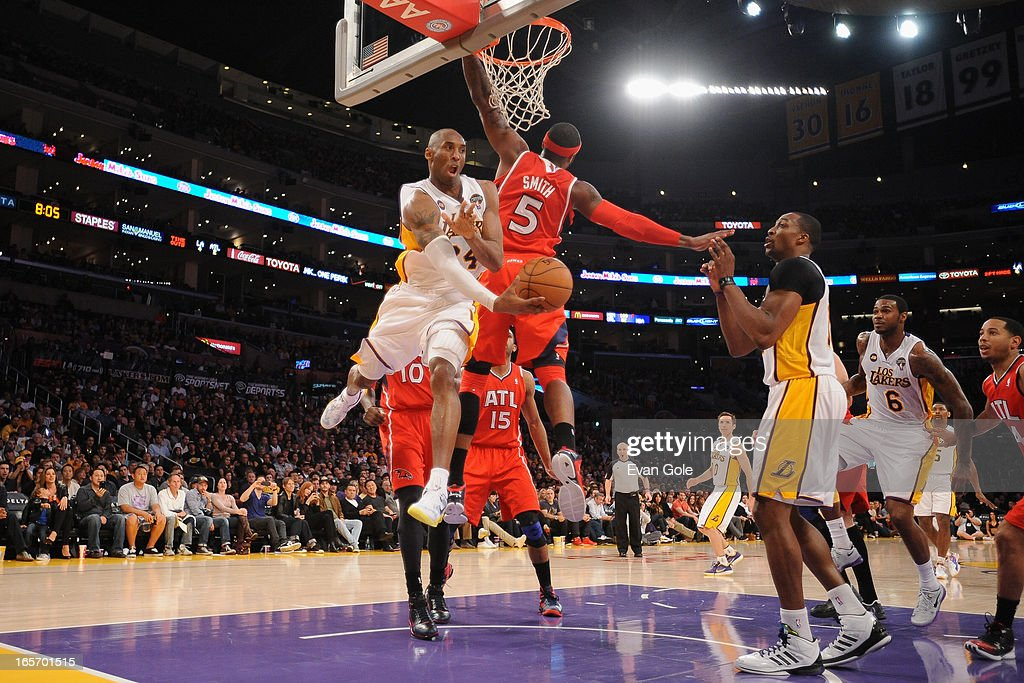 Kobe Bryant #24 of the Los Angeles Lakers drives to the basket against the Atlanta Hawks at Staples Center on March 3, 2013 in Los Angeles, California.