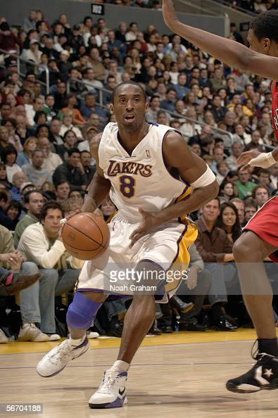 Kobe Bryant of the Los Angeles Lakers drives to the basket against the Toronto Raptors on January 22 2006 at Staples Center in Los Angeles California...