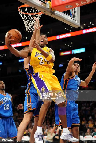 Kobe Bryant of the Los Angeles Lakers drives to the basket against the Oklahoma City Thunder at Staples Center on December 22 2009 in Los Angeles...