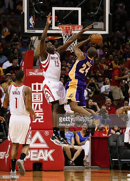 Kobe Bryant of the Los Angeles Lakers drives to the basket as Clint Capela of the Houston Rockets defends at Toyota Center on April 10 2016 in...