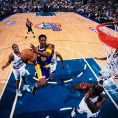 Kobe Bryant of the Los Angeles Lakers drives to the basket for a layup against the Utah Jazz in Game Two of the Western Conference Finals during the...