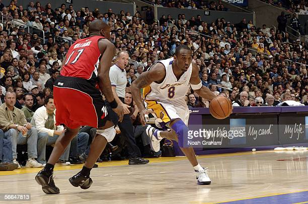 Kobe Bryant of the Los Angeles Lakers drives to the hoop against Eric Williams of the Toronto Raptors on January 22 2006 at Staples Center in Los...