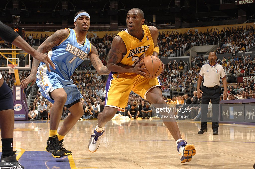 Kobe Bryant of the Los Angeles Lakers drives to the hoop against JR Smith of the Denver Nuggets on April 3 2007 at Staples Center in Los Angeles...