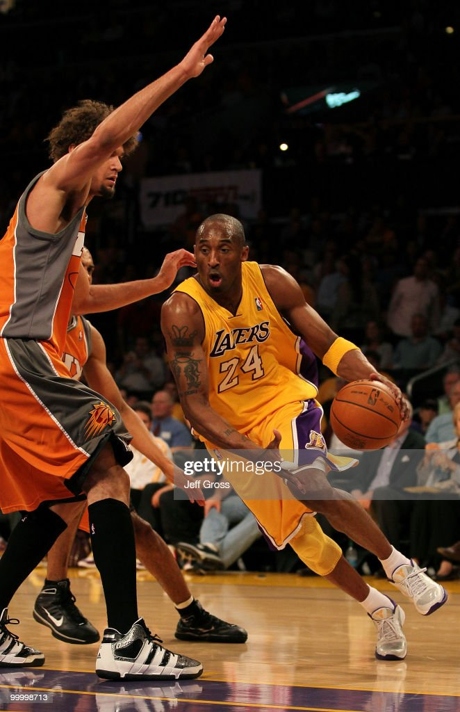 Kobe Bryant #24 of the Los Angeles Lakers drives with the ball against Robin Lopez #15 of the Phoenix Suns in the first quarter of Game Two of the Western Conference Finals during the 2010 NBA Playoffs at Staples Center on May 19, 2010 in Los Angeles, California.