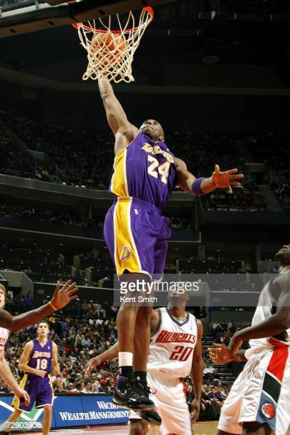 Kobe Bryant of the Los Angeles Lakers dunks against the Charlotte Bobcats on December 29 2006 at the Charlotte Bobcats Arena in Charlotte North...