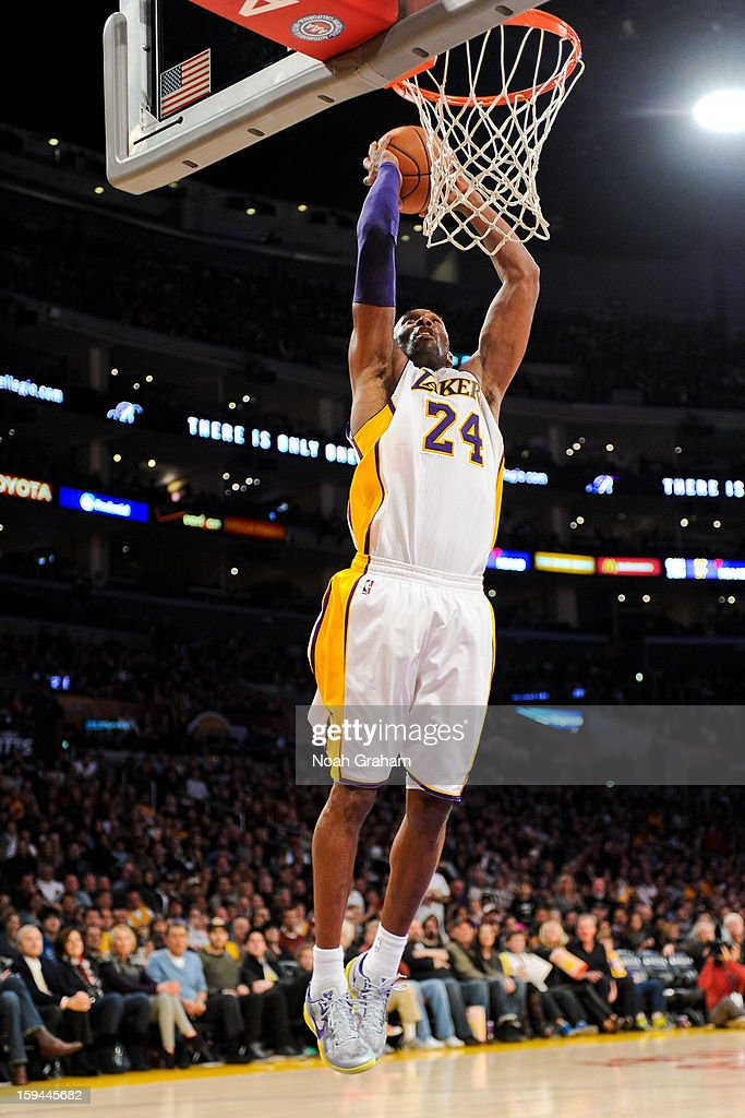 Kobe Bryant #24 of the Los Angeles Lakers dunks against the Cleveland Cavaliers at Staples Center on January 13, 2013 in Los Angeles, California.