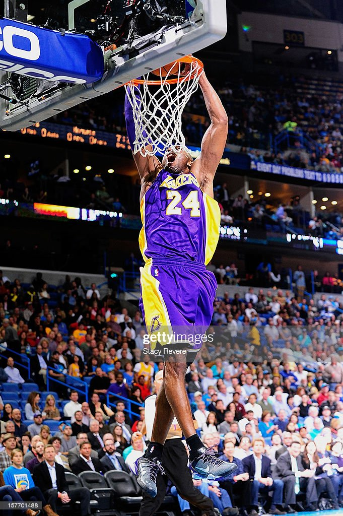 <a gi-track='captionPersonalityLinkClicked' href=/galleries/search?phrase=Kobe+Bryant&family=editorial&specificpeople=201466 ng-click='$event.stopPropagation()'>Kobe Bryant</a> #24 of the Los Angeles Lakers dunks against the New Orleans Hornets at New Orleans Arena on December 5, 2012 in New Orleans, Louisiana. Bryant scored his 30,000th point in tonight's game making him the fifth player in NBA history to reach the achievement.