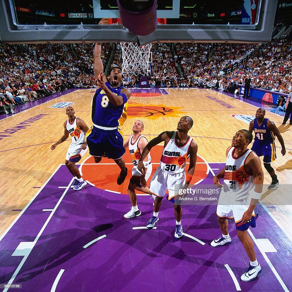 kobe-bryant-of-the-los-angeles-lakers-dunks-against-the-phoenix-suns-picture-id89013196