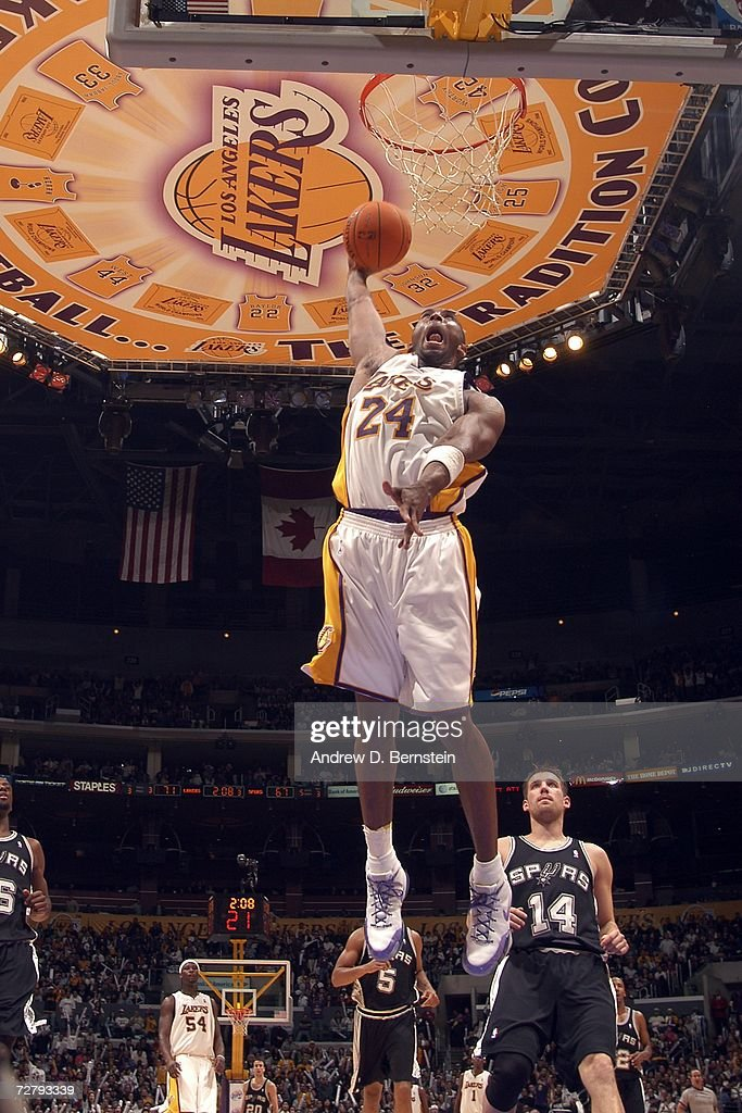 Kobe Bryant #24 of the Los Angeles Lakers dunks against the San Antonio Spurs at Staples Center December 10, 2006 in Los Angeles, California.