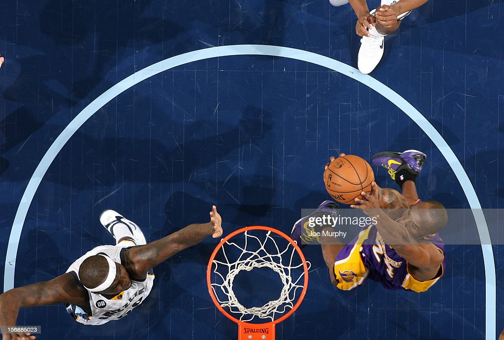 <a gi-track='captionPersonalityLinkClicked' href=/galleries/search?phrase=Kobe+Bryant&family=editorial&specificpeople=201466 ng-click='$event.stopPropagation()'>Kobe Bryant</a> #24 of the Los Angeles Lakers dunks against <a gi-track='captionPersonalityLinkClicked' href=/galleries/search?phrase=Zach+Randolph&family=editorial&specificpeople=201595 ng-click='$event.stopPropagation()'>Zach Randolph</a> #50 and <a gi-track='captionPersonalityLinkClicked' href=/galleries/search?phrase=Rudy+Gay&family=editorial&specificpeople=236066 ng-click='$event.stopPropagation()'>Rudy Gay</a> #22 of the Memphis Grizzlies on November 23, 2012 at FedExForum in Memphis, Tennessee.