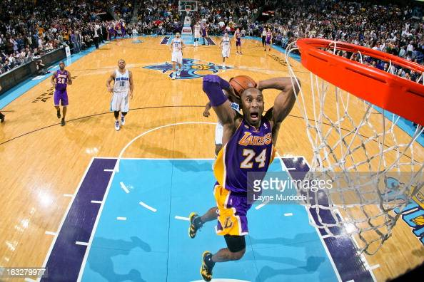 Kobe Bryant of the Los Angeles Lakers dunks on a fast break against the New Orleans Hornets on March 6 2013 at the New Orleans Arena in New Orleans...