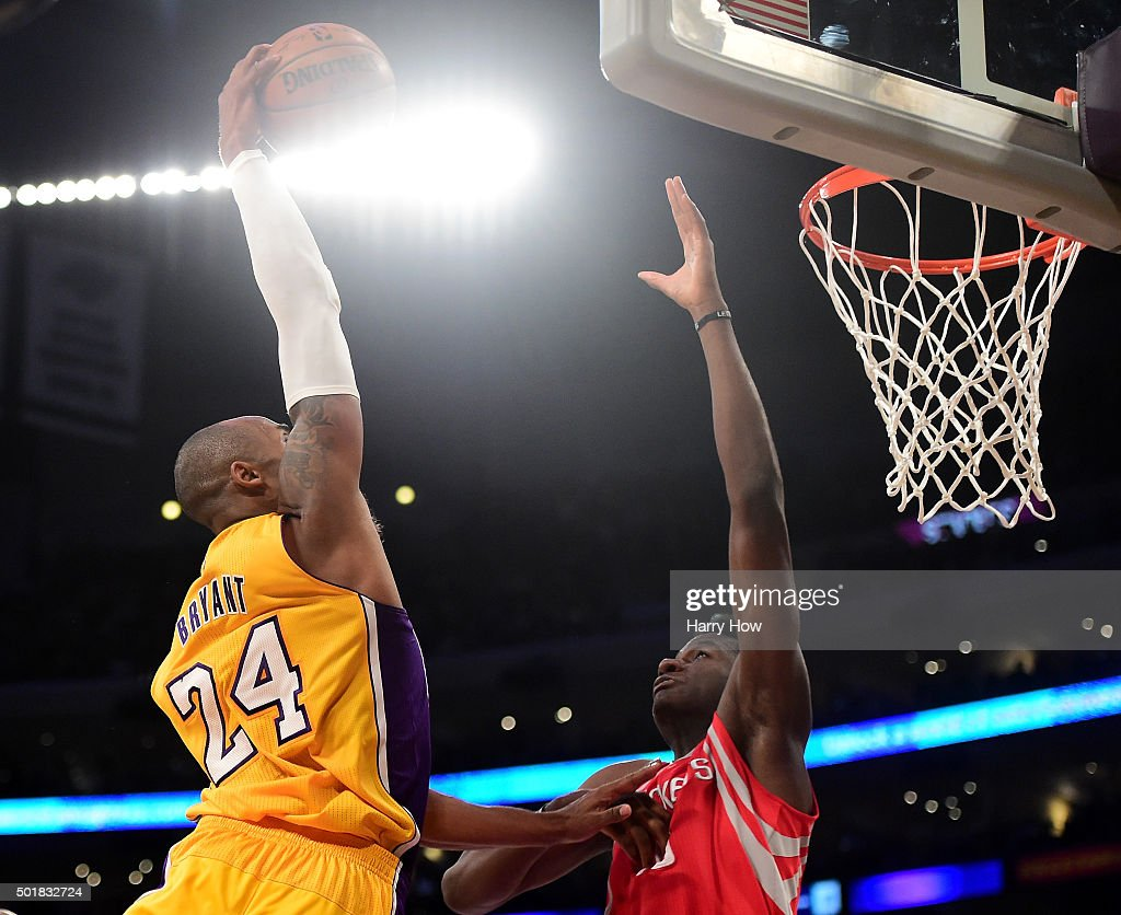 Kobe Bryant of the Los Angeles Lakers dunks over Clint Capela of the Houston Rockets during a 10787 Rockets win at Staples Center on December 17 2015...