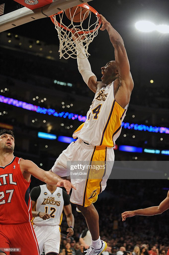 Kobe Bryant #24 of the Los Angeles Lakers dunks the ball against the Atlanta Hawks at Staples Center on March 3, 2013 in Los Angeles, California.