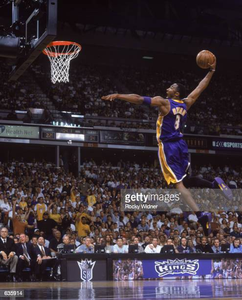 Kobe Bryant of the Los Angeles Lakers dunks the ball during game 1 of the Western Conference Finals during the 2002 NBA Playoffs against the...