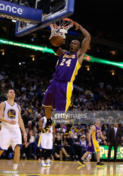 Kobe Bryant of the Los Angeles Lakers dunks the ball during their game against the Golden State Warriors at Oracle Arena on December 22 2012 in...