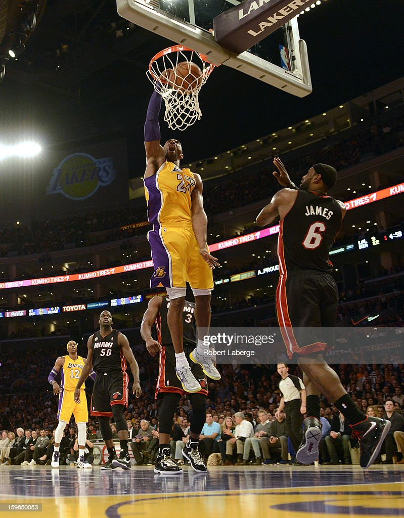Kobe Bryant #24 of the Los Angeles Lakers dunks the ball in front of Lebron James #9 of the Miami Heat at Staples Center on January 17, 2013 in Los Angeles, California.