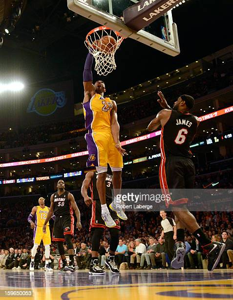 Kobe Bryant of the Los Angeles Lakers dunks the ball in front of Lebron James of the Miami Heat at Staples Center on January 17 2013 in Los Angeles...