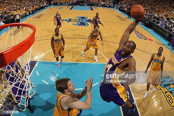 Kobe Bryant of the Los Angeles Lakers dunks the ball over Aaron Gray of the New Orleans Hornets in Game Three of the Western Conference Quarterfinals...