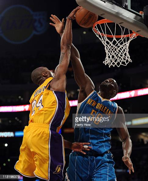 Kobe Bryant of the Los Angeles Lakers dunks the ball over Emeka Okafor of the New Orleans Hornets in the second quarter in Game Five of the Western...