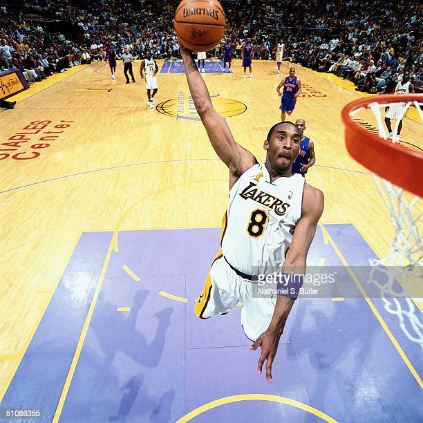 Kobe Bryant of the Los Angeles Lakers dunks the ball past Chauncey Billups of the Detroit Pistons during Game One of the 2004 NBA Finals on June 6...