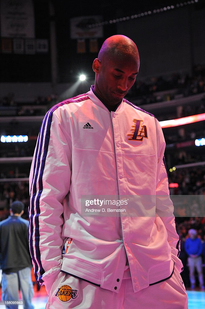 Kobe Bryant #24 of the Los Angeles Lakers during the national anthem before the game against the Utah Jazz at Staples Center on December 9, 2012 in Los Angeles, California.