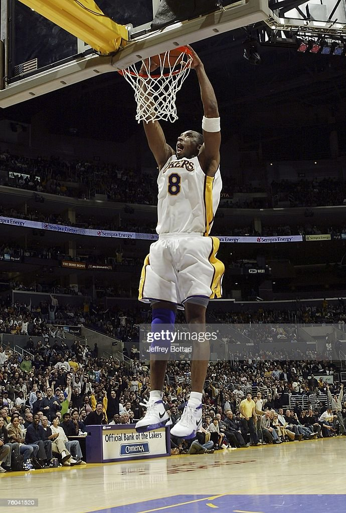 Kobe Bryant of the Los Angeles Lakers elevates for a dunk against the Toronto Raptors during his 81 point explosion on January 22 2006 at Staples...