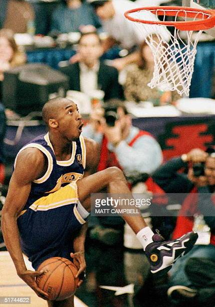 Kobe Bryant of the Los Angeles Lakers eyes the basket during the NBA Slam Dunk contest 08 February at Gund Arena in Cleveland Ohio Bryant is the...
