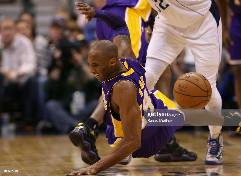 <a gi-track='captionPersonalityLinkClicked' href=/galleries/search?phrase=Kobe+Bryant&family=editorial&specificpeople=201466 ng-click='$event.stopPropagation()'>Kobe Bryant</a> #24 of the Los Angeles Lakers falls after fouled by O.J. Mayo #32 of the Dallas Mavericks at American Airlines Center on February 24, 2013 in Dallas, Texas.