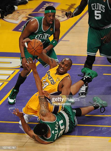 Kobe Bryant of the Los Angeles Lakers falls down as Rasheed Wallace of the Boston Celtics goes after the ball in the first quarter of Game Seven of...