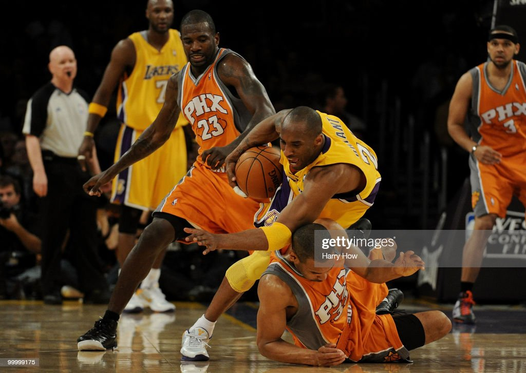 Kobe Bryant #24 of the Los Angeles Lakers falls over Grant Hill #33 of the Phoenix Suns in the first quarter of Game Two of the Western Conference Finals during the 2010 NBA Playoffs at Staples Center on May 19, 2010 in Los Angeles, California.