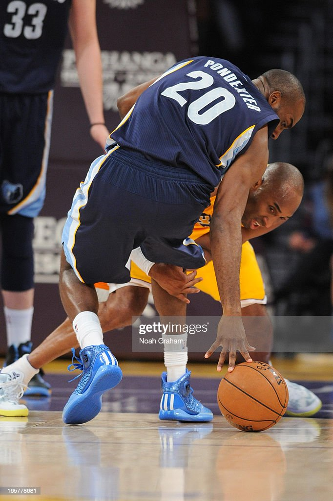 Kobe Bryant #24 of the Los Angeles Lakers fights for a loose ball against Quincy Pondexter #20 of the Memphis Grizzlies at Staples Center on April 5, 2013 in Los Angeles, California.