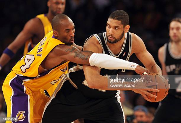 Kobe Bryant of the Los Angeles Lakers fights for the ball with Tim Duncan of the San Antonio Spurs in Game Two of the Western Conference Finals...