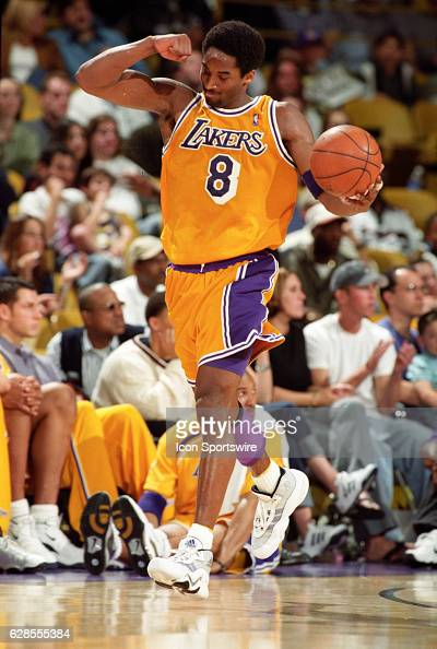 Kobe Bryant of the Los Angeles Lakers flexes his bicep as he dribbles the ball down court during a National Basketball Association game at the Great...
