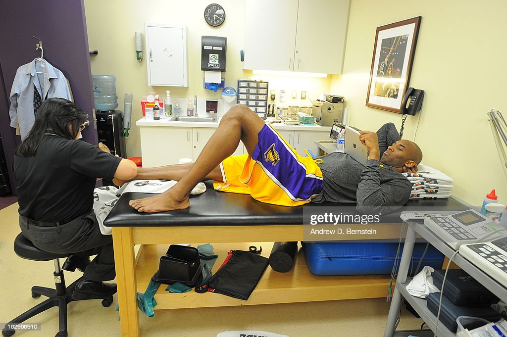 <a gi-track='captionPersonalityLinkClicked' href=/galleries/search?phrase=Kobe+Bryant&family=editorial&specificpeople=201466 ng-click='$event.stopPropagation()'>Kobe Bryant</a> #24 of the Los Angeles Lakers gets his leg looked at prior to the game against the Los Angeles Clippers at Staples Center on February 14, 2013 in Los Angeles, California.
