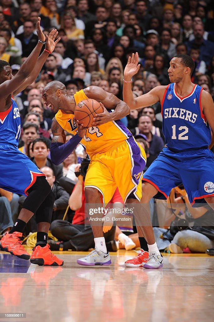 Kobe Bryant #24 of the Los Angeles Lakers gets tied up against the Philadelphia 76ers defense at Staples Center on January 1, 2013 in Los Angeles, California.