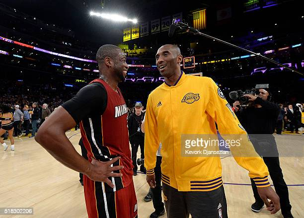 Kobe Bryant of the Los Angeles Lakers gets together with Dwyane Wade of the Miami Heat after the basketball game at Staples Center March 30 in Los...